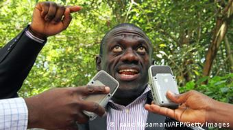 Ugandan opposition activist Kizza Besigye addresses the media during a press conference in Kampala on March 26, 2013. Besigye claims he wants Uganda?s Inspector General of Police Maj. Gen. Kale Kayihura and his deputy Felix Kaweesi to face charges at the International Criminal Court for conspiracy to cause a felony. AFP PHOTO / ISAAC KASAMANI (Photo credit should read ISAAC KASAMANI/AFP/Getty Images)