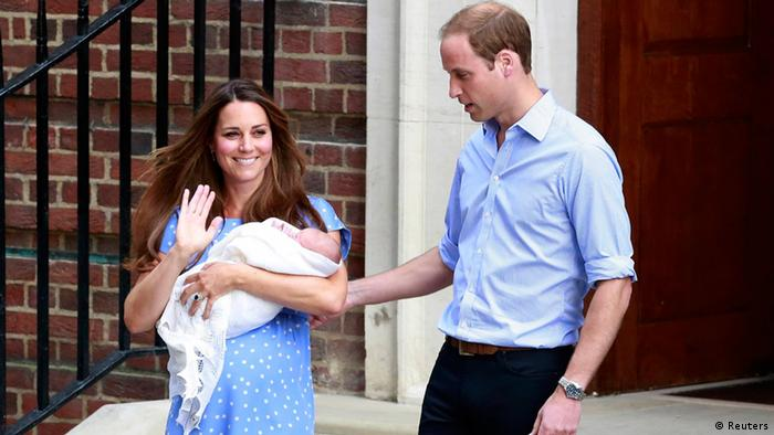 Prince William and his wife Catherine appear with their baby son outside the Lindo Wing of St Mary's Hospital, July 23, 2013.