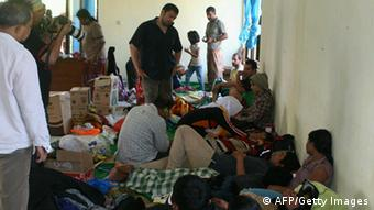 Survivors rest in a village center in Cidaun, West Java prorince on July 24, 2013 (Photo: read STR/AFP/Getty Images)