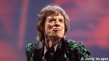 GLASTONBURY, ENGLAND - JUNE 29: Sir Mick Jagger of The Rolling Stones performs on the Pyramid Stage at Glastonbury Festival 2013 on June 29, 2013 in Glastonbury, England. at the Glastonbury Festival of Contemporary Performing Arts site at Worthy Farm, Pilton on June 29, 2013 near Glastonbury, England. The wholesale market caters for traders throughout the Festival who are estimated to provide 3 million meals for festival goers, crew and performers. Gates opened on Wednesday at the Somerset diary farm that will be playing host to one of the largest music festivals in the world and this year features headline acts Artic Monkeys, Mumford and Sons and the Rolling Stones. Tickets to the event which is now in its 43rd year sold out in minutes and that was before any of the headline acts had been confirmed. The festival, which started in 1970 when several hundred hippies paid 1 GBP to watch Marc Bolan, now attracts more than 175,000 people over five days. (Photo by Matt Cardy/Getty Images)