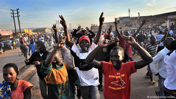 People protesting in Kampala. (Photo: EPA/YANNICK TYLLE)
