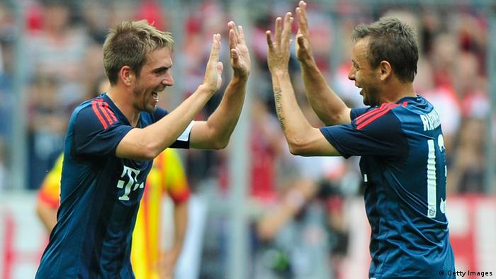 MUNICH, GERMANY - JULY 24: Philipp Lahm (L) and Rafinha of Muenchen celebrate the opening goal during the Uli Hoeness Cup match between FC Bayern Muenchen and FC Barcelona at Allianz Arena on July 24, 2013 in Munich, Germany. (Photo by Lennart Preiss/Bongarts/Getty Images)