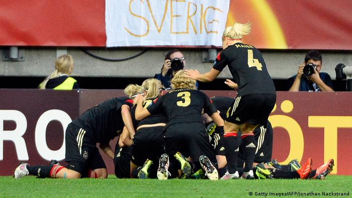 Germany's forward Dzsenifer Marozsan celebrates with her teammates after scoring past Sweden's goalkeeper Kristin Hammarstrom during the UEFA Women's European Championship Euro 2013 semi final football match Sweden vs Germany on July 24, 2013 in Gothenburg, Sweden. AFP PHOTO/JONATHAN NACKSTRAND (Photo credit should read JONATHAN NACKSTRAND/AFP/Getty Images)