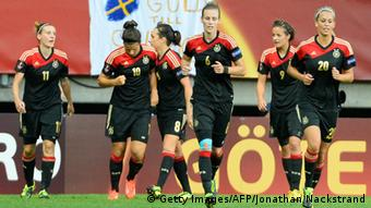 Germany's forward Dzsenifer Marozsan (2nd-L) celebrates with her teammates after scoring past Sweden's goalkeeper Kristin Hammarstrom during the UEFA Women's European Championship Euro 2013 semi final football match Sweden vs Germany on July 24, 2013 in Gothenburg, Sweden. AFP PHOTO/JONATHAN NACKSTRAND (Photo credit should read JONATHAN NACKSTRAND/AFP/Getty Images)