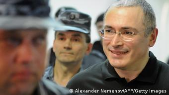 A guard escorts former Yukos oil company CEO Mikhail Khodorkovsky (C) to a courtroom in Moscow, where he will stand as a witness in a trial in absentia of former associate Russian-born Spaniard Antonio Valdez Garcia, who was the head of Yukos subsidiary Fargoil company and is accused of embezzlement. AFP PHOTO / ALEXANDER NEMENOV (Photo credit should read ALEXANDER NEMENOV/AFP/Getty Images) 02 Jun 2011