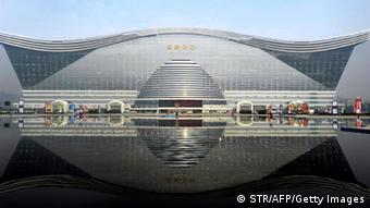 The 'New Century Global Centre' building opens to the public in Chengdu, southwest China's Sichuan province on June 28, 2013. The center, claimed by Chinese officials to be 'the world's largest standalone structure', measuring 500 metres in length and 400 metres in width, with 1.7 million square metres of floor space -- big enough to hold 20 Sydney Opera Houses -- is the latest symbol of China's economic boom. CHINA OUT AFP PHOTO (Photo credit should read STR/AFP/Getty Images)