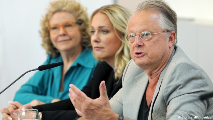 Castorf speaks at a press conference alongside the Bayreuth Festival's co-directors Photo: Tobias Hase/dpa