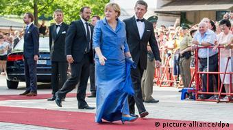 Меркель з чоловіком- постійні почесні гості на відкритті фестивалю, проте цього року їх не буде на церемонії