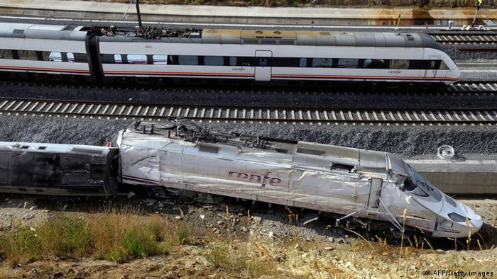 A train passes the scene of a train crash on July 26, 2013 at Angrois, near Santiago de Compostela, Spain. A train hurtled off the tracks on July 24, 2013 in northwest Spain killing at least 80 passengers and injuring more than 140, an official said today, the country's deadliest rail disaster in more than 40 years. AFP PHOTO/ MIGUEL RIOPA (Photo credit should read MIGUEL RIOPA/AFP/Getty Images)