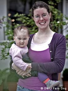 Diaper-free practitioner and coach Freya Donner holds her baby daughter, Alice Sam, in her arms