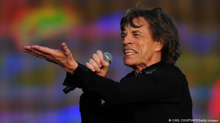 English singer Mick Jagger performs with the Rolling Stones during the British Summertime Hyde Park concert in central London on July 13, 2013. AFP PHOTO / CARL COURT (Photo credit should read CARL COURT/AFP/Getty Images)