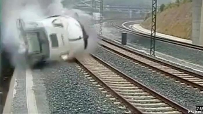A train derails in this still image from the video of a security camera near Santiago de Compostela, northwestern Spain, July 24, 2013. REUTERS/CCTV via Reuters TV