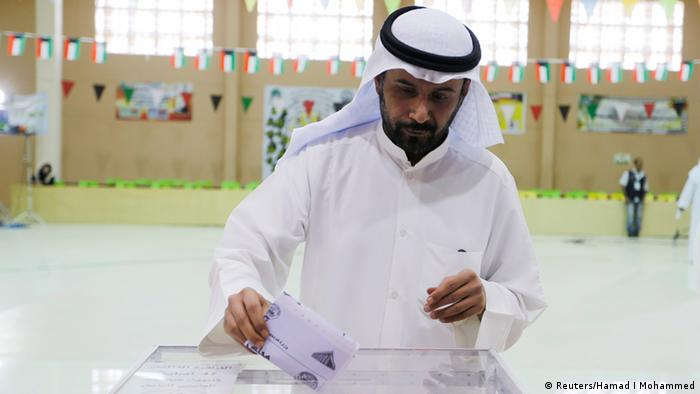 A voter casts his ballot during elections in District 3 Khaldeya, Kuwait City July 27, 2013. A boycott by some opposition Islamists may help liberals and independents in Kuwait's election on Saturday, but there are signs that voters are flagging as they go to the polls for the sixth time in seven years. REUTERS/Hamad I Mohammed (KUWAIT - Tags: POLITICS ELECTIONS)