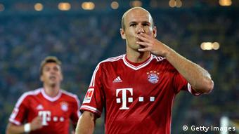 DORTMUND, GERMANY - JULY 27: Arjen Robben of Bayern Muenchen celebrates after scoring his team's first goal during the DFL Supercup match between Borussia Dortmund and FC Bayern Muenchen at Signal Iduna Park on July 27, 2013 in Dortmund, Germany. (Photo by Dennis Grombkowski/Bongarts/Getty Images)