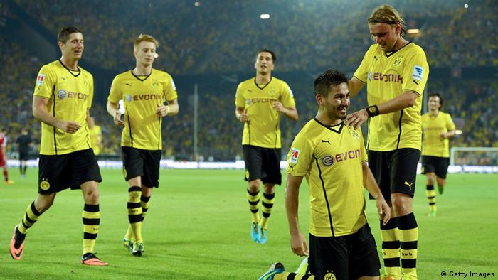 DORTMUND, GERMANY - JULY 27: Ilkay Guendogan (2-R) of Dortmund celebrates scoring his team's 3rd goal with team mates during the DFL Supercup match between Borussia Dortmund and FC Bayern Muenchen at Signal Iduna Park on July 27, 2013 in Dortmund, Germany. (Photo by Sascha Steinbach/Bongarts/Getty Images)