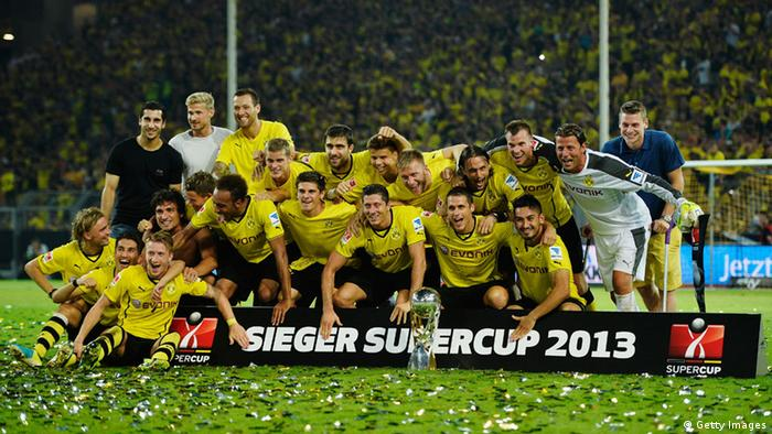 DORTMUND, GERMANY - JULY 27: Borussia Dortmund players celebrate after winning the DFL Supercup match between Borussia Dortmund and FC Bayern Muenchen at Signal Iduna Park on July 27, 2013 in Dortmund, Germany. (Photo by Dennis Grombkowski/Bongarts/Getty Images)