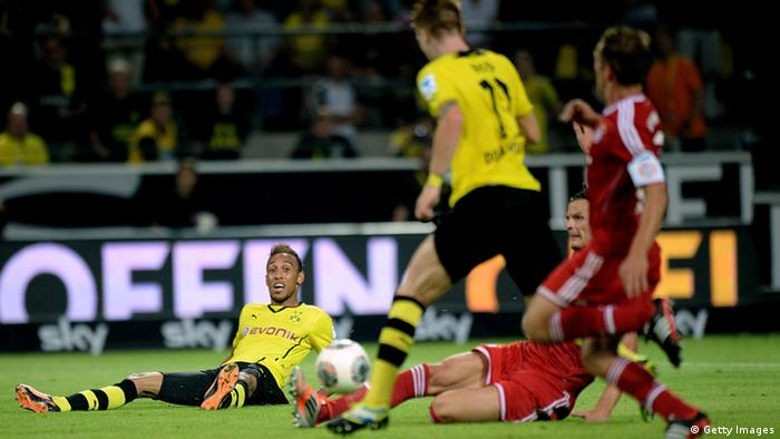 DORTMUND, GERMANY - JULY 27: Marco Reus (C) of Dortmund scores his team's 4th goal after a pass from Pierre-Emerick Aubameyang (L) of Dortmund during the DFL Supercup match between Borussia Dortmund and FC Bayern Muenchen at Signal Iduna Park on July 27, 2013 in Dortmund, Germany. (Photo by Sascha Steinbach/Bongarts/Getty Images)