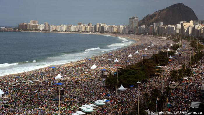 Hundreds of thousands of people crowd Copacabana beach in Rio de Janeiro on July 28, 2013 waiting for the arrival of Pope Francis for the final mass of his visit to Brazil. Throngs of pilgrims attending World Youth Day (WYD) spent the night sleeping on the beach before Sunday's final mass, while the city's mayor said he expects up to three million people to pack the beach for the occasion. AFP PHOTO / VANDERLEI ALMEIDA (Photo credit should read VANDERLEI ALMEIDA/AFP/Getty Images)