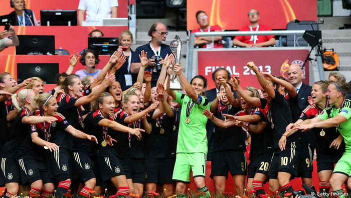 SOLNA, SWEDEN - JULY 28: Nadine Angerer (C), goalkeeper of Germany lifts the trophy after the UEFA Women's EURO 2013 final match between Germany and Norway at Friends Arena on July 28, 2013 in Solna, Sweden. (Photo by Martin Rose/Getty Images)