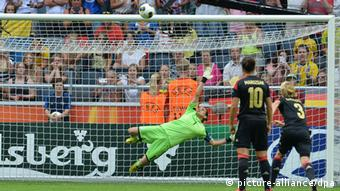 Germany goalkeeper Nadine Angerer saves a penalty in the European Women's Championships. Photo: Carmen Jaspersen/dpa
