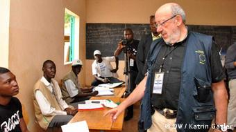 Louis Michel checking a polling station