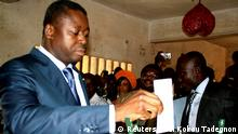 REFILE - CORRECTING BYLINE AND UPDATING SECOND SENTENCE President of Togo Faure Gnassingbe (L) casts his ballot inside a school in Lome July 25, 2013. Togolese voted today to select new members of the country's legislative assembly, according to local media. REUTERS/Noel Kokou Tadegnon (TOGO - Tags: POLITICS ELECTIONS)