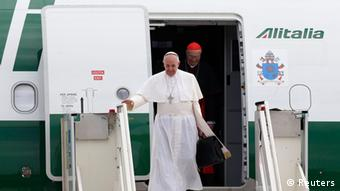 Pope Francis (L) and Cardinal Tarcisio Bertone step off a plane after returning from their trip to Brazil at Ciampino airport, south of Rome, July 29, 2013. Pope Francis left Brazil on Sunday with Rio still pulsating with excitement after a historic beachfront Mass for more than 3 million people in which he challenged young people to build a new world based on tolerance and love. REUTERS/Alessandro Bianchi (ITALY - Tags: RELIGION POLITICS TRANSPORT)