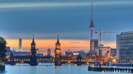 The Berlin cityscape in the evening, taking in the TV Tower and Oberbaum Bridge