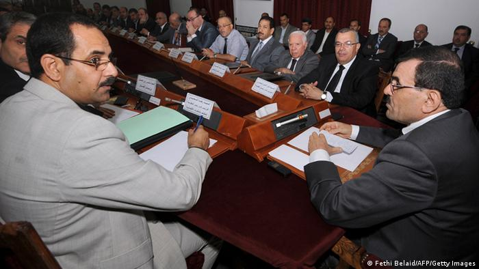 Tunisian Prime Minister Ali Larayedh (R) chairs an emergency meeting with the Council of Ministers on 29 July 2013 in Tunis to discuss measures following the assassination of opposition figure Mohamed Brahmi. Tensions have spiralled in Tunisia since the murder on July 25 of opposition MP Brahmi, the second anti-Islamist figure gunned down in six months. AFP PHOTO / FETHI BELAID (Photo credit should read FETHI BELAID/AFP/Getty Images)