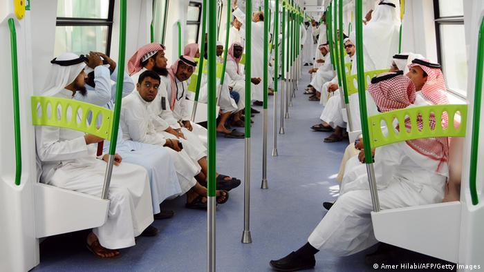 Saudi Arabian men ride on the newly-opened Holy Sites metro light rail in the western Saudi city of Mecca on November 2, 2010. The Chinese-built monorail project, will link Mecca with the holy sites of Mina, Arafat and Muzdalifah, and will operate for the first time during the Hajj this month at 35 percent capacity to ferry Saudi nationals who will take part in the upcoming annual Muslim pilgrimage. AFP PHOTO/AMER HILABI (Photo credit should read AMER HILABI/AFP/Getty Images)
