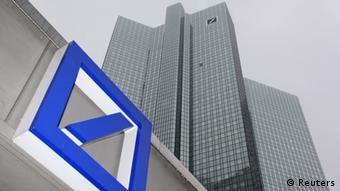 File photo of a Deutsche Bank logo in front of the Deutsche Bank headquarters in Frankfurt February 24, 2011. Financial data company Markit, the International Swaps and Derivatives Association (ISDA) and 13 banks were charged July 1, 2013, with blocking two exchanges from entering the credit derivatives market in the last decade in breach of EU antitrust rules. The European Commission said the group, which included Citigroup, Goldman Sachs and UBS, shut out Deutsche Boerse and the Chicago Mercantile Exchange from the CDS business between 2006 and 2009. The charges followed a two-year investigation. The other banks charged are Bank of America Merrill Lynch, Barclays, Bear Stearns, BNP Paribas, Morgan Stanley, Credit Suisse, Deutsche Bank, HSBC, JP Morgan and RBS. REUTERS/Ralph Orlowski/Files (GERMANY - Tags: BUSINESS)
