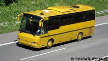 A stock image showing a yellow bus driving along a highway (Fotolia/B. Wylezich)