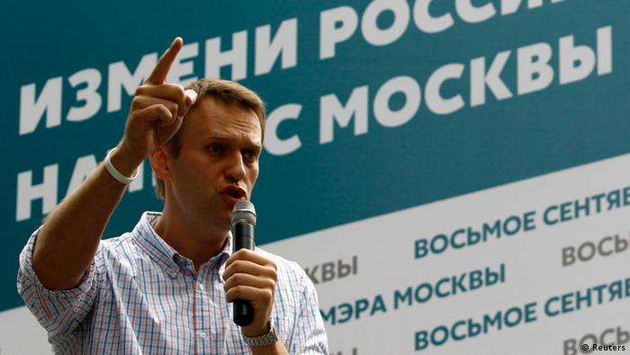 Russia's opposition leader Navalny speaks to the crowd in Moscow July 30, 2013.