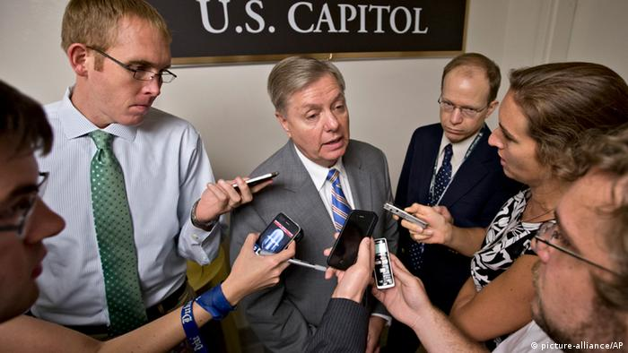 Sen. Lindsey Graham, R-S.C., center, is surrounded by reporters on Capitol Hill in Washington, Tuesday, July 30, 2013, during a roll call. Graham said on Tuesday that President Barack Obama has asked him and Sen. John McCain, R-Ariz. to travel to Egypt to urge the military to move ahead on elections. (AP Photo/J. Scott Applewhite)