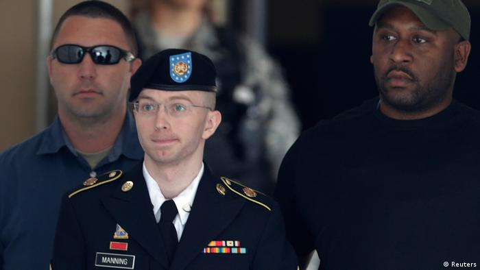 U.S. Army Private First Class Bradley Manning (C) departs the courthouse at Fort Meade, Maryland July 30, 2013. A military judge on Tuesday found Manning not guilty of aiding the enemy - the most serious charge among many he faced for handing over documents to WikiLeaks. But Col. Denise Lind, in her verdict, found Manning, 25, guilty of 19 of the other 20 criminal counts in the biggest breach of classified information in the nation's history. REUTERS/Gary Cameron (UNITED STATES - Tags: CRIME LAW MILITARY POLITICS)