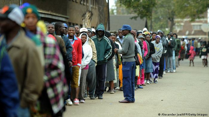 Zimbabweans line up near a polling station in Harare (Photo: ALEXANDER JOE/AFP/Getty Images)