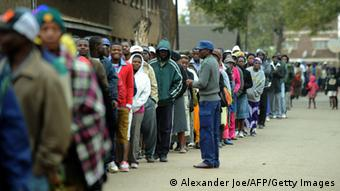 Zimbabweans line up near a polling station in Harare (Photo ALEXANDER JOE/AFP/Getty Images)
