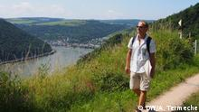 Man hiking on the new Turner Route on the banks of the Rhine Photo: Anne Termeche / DW