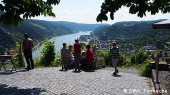 A group picnics on a vantage point above Oberwesel