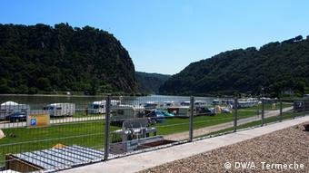 Campers line the banks of the Rhine River