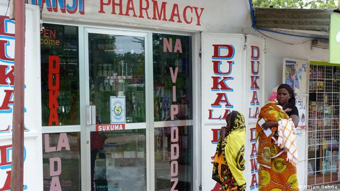 Rehema Mohammed goes to a pharmacy to redeem a mosquito net voucher