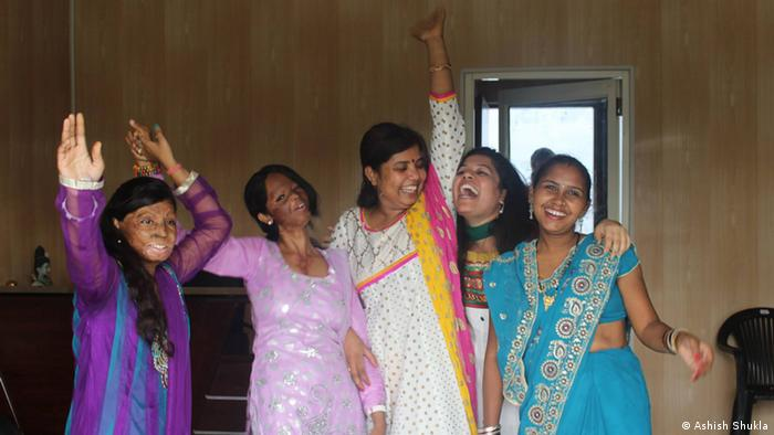 Rupa (left) and Laxmi dance with volunteers (Photo: Ashish Shukla)