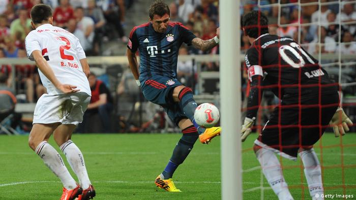 Mario Mandzukic of Bayern Muenchen scores the opening goal during the Audi Cup semi-final between FC Bayern Muenchen and FC Sao Paulo at Allianz Arena on July 31, 2013 in Munich, Germany. (Photo by Stuart Franklin/Bongarts/Getty Images)