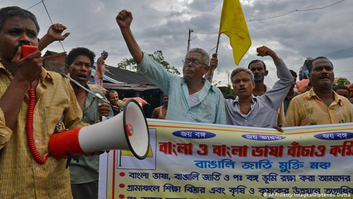 Bangla O Bangla Bhasa Bachao Committee activists shout slogans against formation of Gorkhaland on the eve of a 48-hour opposing strike in Siliguri on July 31, 2013, on the final day of a 72-hour strike called by Gorkha People's Liberation Front (GJM) that coincided with the decision by the Congress leadership approving the creation of Telangana. (Photo: DIPTENDU DUTTA/AFP/Getty Images)