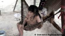 An Awa woman and monkey in Brazil. (Photo: Domenico Pugliese/Survival)