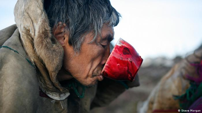 A Nenet man has a drink (Photo: Steve Morgan)