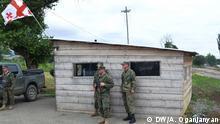 Georgische Polizeiwache an der Grenze zwischen Georgien und Südossetien. Autor: Amalia Oganjanyan, DW-Korrespondentin in Tbilissi, 30.07.2013.