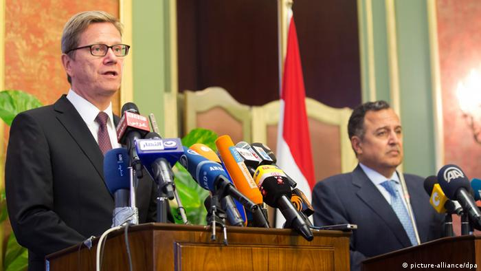 German Foreign Minister Guido Westerwelle speaking at a news conference next to his Egyptian counterpart Nabil Fahmi Photo: Michael Kappeler/dpa