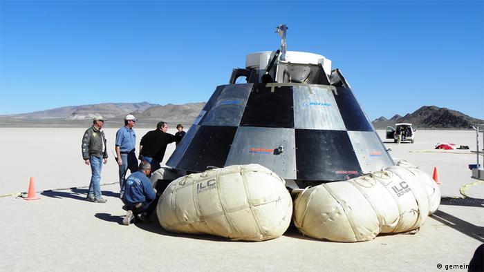 Personnel inspect the CST-100 following the parachute drop test. Copyright: BLM Nevada
