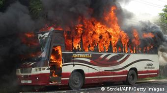 A bus, allegedly set on fire by demonstrating Bangladesh Jamaat-e-Islami activists following a verdict banning the party from contesting next year's elections, burns in Bogra, some 120kms north of Dhaka, on August 1, 2013. Bangladesh's main Islamist party was banned from contesting next year's election when the high court ruled that Jamaat-e-Islami's charter breached the country's secular constitution. AFP PHOTO/STR (Photo credit should read STRDEL/AFP/Getty Images)